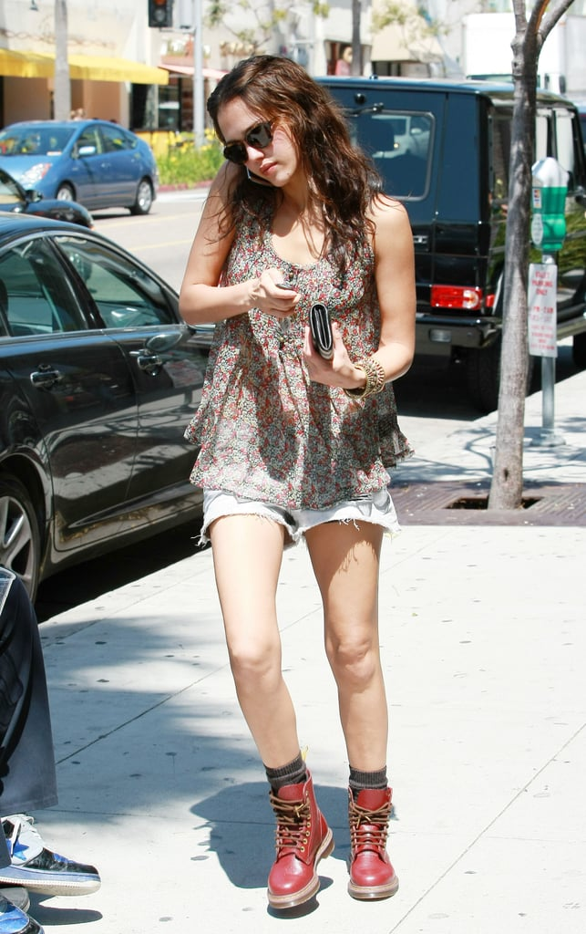 Jessica showed off her gorgeous gams in a sheer printed blouse, denim cutoffs, and Dr. Martens lace-up boots in Beverly Hills.