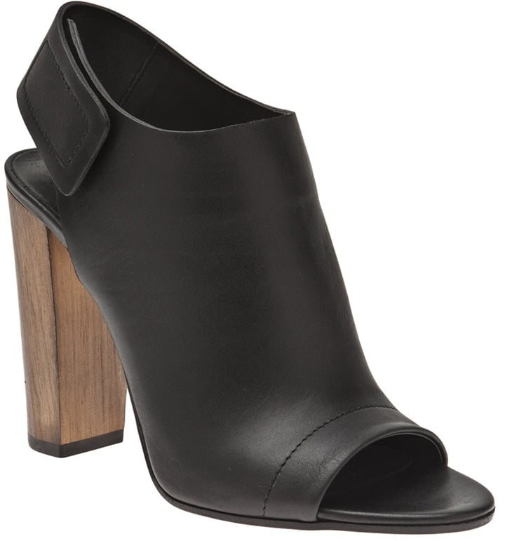 Thanks to a great stacked-wood heel, these Vince Astrid booties ($375) add more interest than your basic black ankle boots.