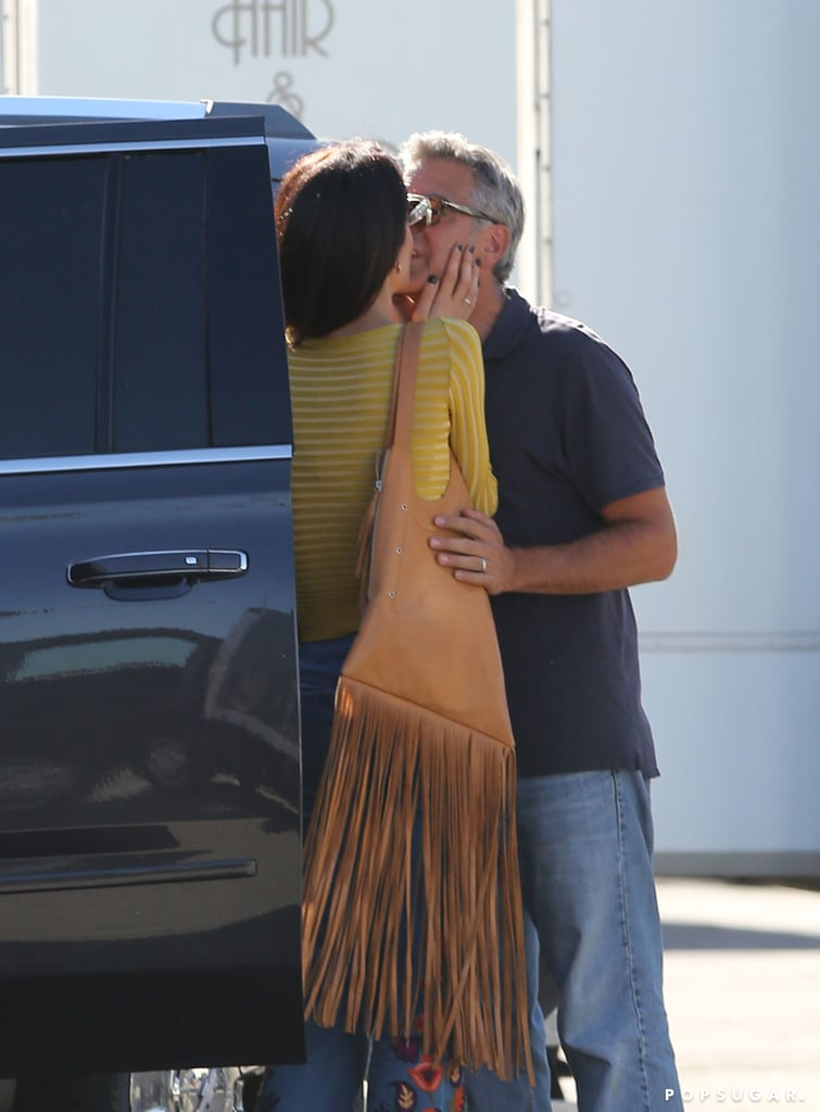 George Clooney got a special visit from his wife, Amal, on the set of his upcoming film, Suburbicon, in LA on Thursday. The couple walked hand in hand as they took their rescue dog Millie for a walk. While George kept things casual in a polo and jeans, Amal gave off serious '70s vibes with a fitted yellow top and embroidered denim bell-bottoms. Later, they showed a little PDA as they snuck a few kisses near their car. Their recent outing is just the latest we've seen of the couple. After taking a casual stroll in NYC ahead of their wedding anniversary, the two recently wowed at Hollywood's Night Under the Stars.      Related:                                                                                                           37 Times George and Amal Clooney Looked Madly in Love