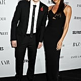 Brooklyn and Victoria Beckham made it a family affair on the Harper's Bazaar UK carpet to celebrate the Women of the Year Awards.
