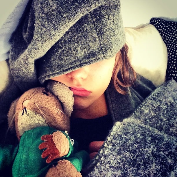 Karlie Kloss cuddled up with her favorite stuffed animal while spending the day sick in bed. Source: Instagram user karliekloss