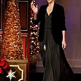 Charlize hit the stage in a long maxi dress and black jacket.