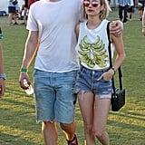 Evan Peters kept a protective arm around then-girlfriend Emma Roberts in 2014.