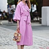 A Pink Coat Dress and Gold Shoes