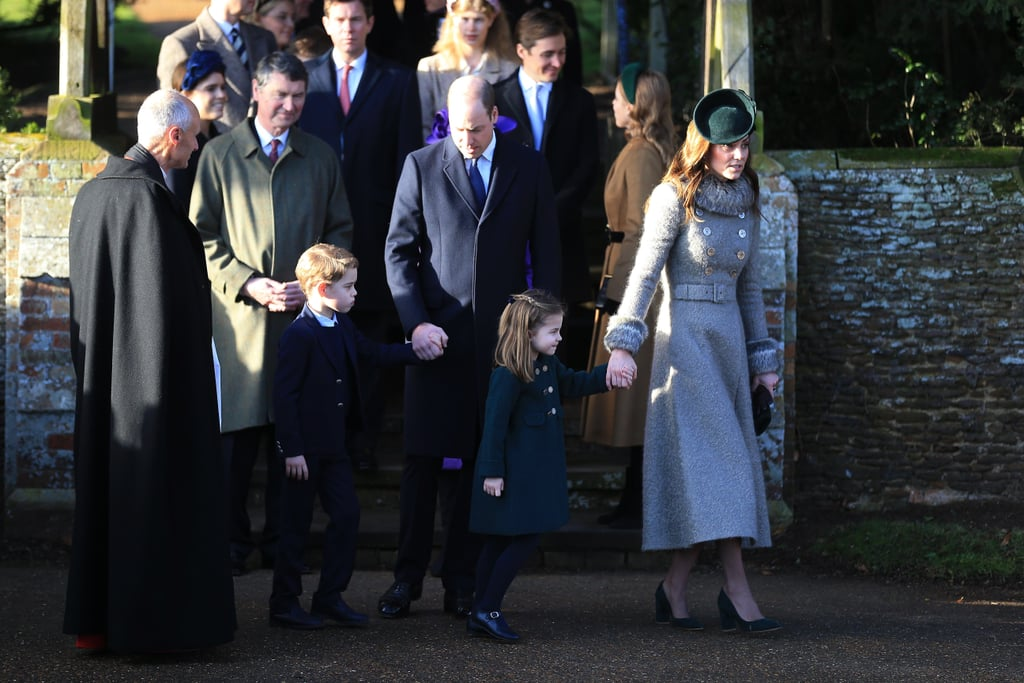 """After a busy year of ups and downs, members of the British royal family were in fine form as they made their annual appearance at St. Mary Magdalene Church in Sandringham for the Christmas service. The family traditionally makes two visits to the church on Christmas Day, the first is a more private and informal trip for the queen to take communion. The second is the one we've come to know and love, as the whole family steps out in their best coats and hats to greet locals and photographers as the make their way to a mid-morning service. Last year all eyes were on the """"fab four"""" as William, Kate, Harry, and Meghan made the trip together, smiling and chatting as they did so. This year, however, Harry and Meghan have chosen to celebrate baby Archie's first Christmas with Meghan's mother, Doria Ragland, rather than attending the big royal celebration. Though this has caused some controversy, it's actually in keeping with the trend set by William and Kate, who also skipped the Sandringham festivities for their second Christmas as a married couple, choosing to celebrate with the Middleton family instead. Although Harry, Meghan, and Archie stayed away, there were some other exciting attendees to keep us entertained. For the first time, Prince George and Princess Charlotte joined their parents for the walk to church, and as you can imagine, they were the stars of the show as they waved to the crowds while holding tightly to their parents' hands. Alongside her majesty the queen, William and Kate took centre stage for this royal Christmas, with Kate dressed in her usual festive coat. They were joined by a number of other family members, including Prince Charles and Camilla, Princess Anne, and more. Keep reading to see all the festive photos."""