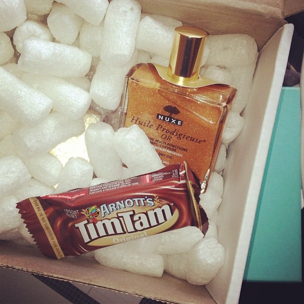 A beauty delivery, complete with a Tim Tam? Nothing better! This Nuxe dry oil for face, body and hair is becoming a cult fave in our office.