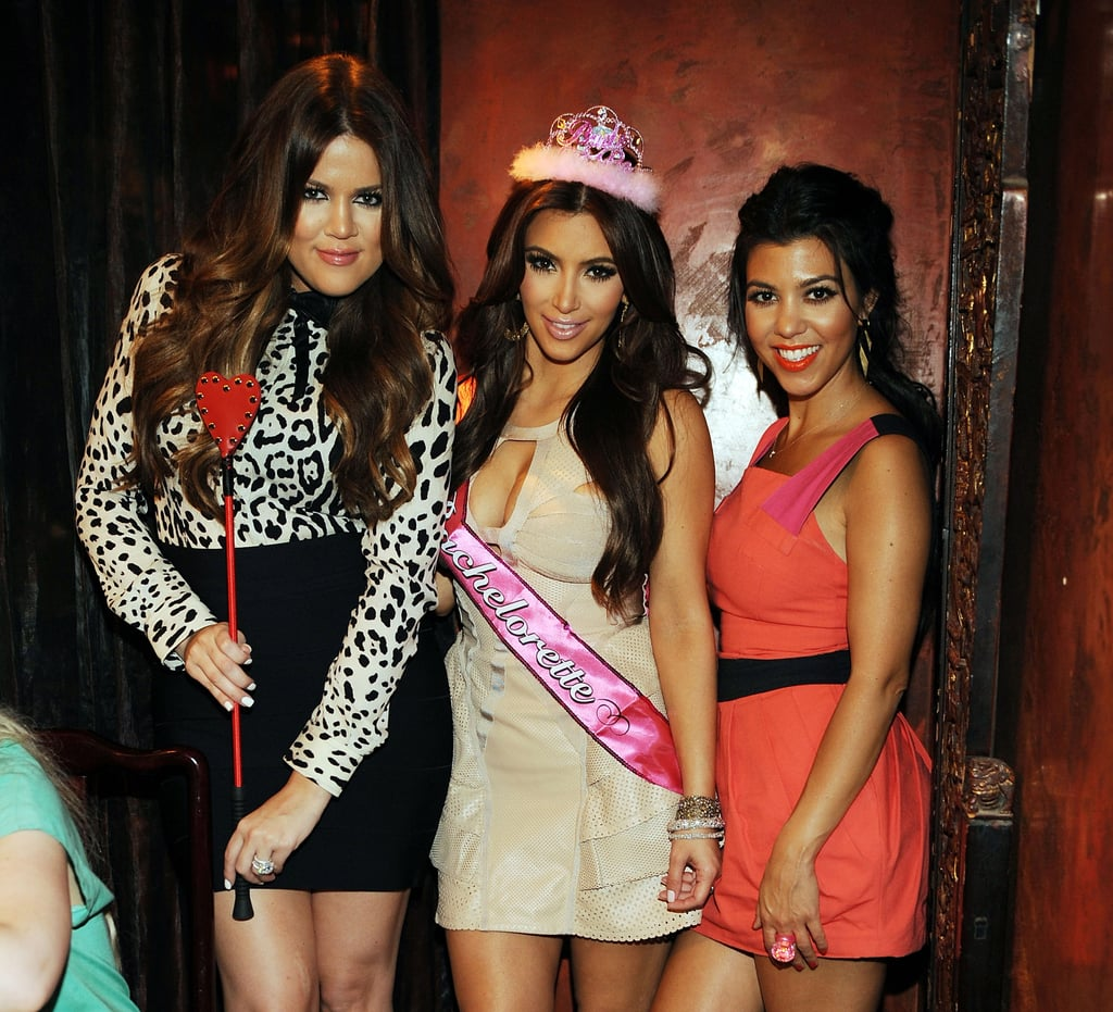 Khloe, Kim, and Kourtney Kardashian posed for a photo.