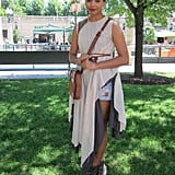Like a true bohemian, Brayleen hit up Grant Park in a handmade dress over ripped cutoffs. To complete the look, she paired it with a vintage leather purse and open-toe All Saints boots.