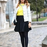 A tweed topper and a chain collar necklace gave a ladylike ensemble a touch of the trends.