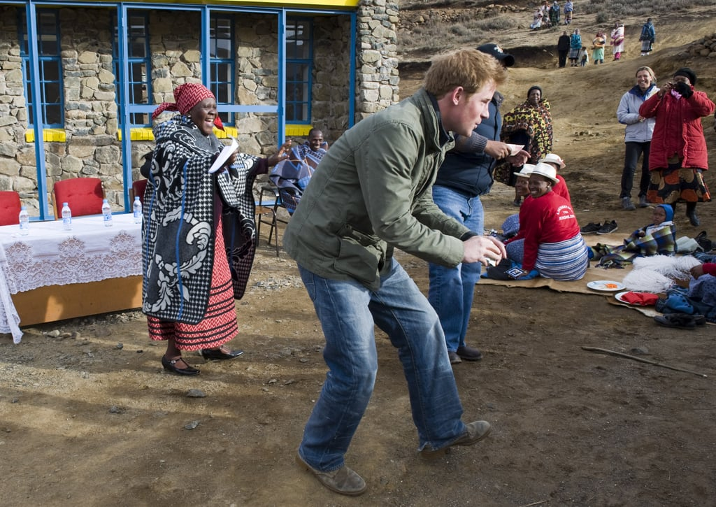 Harry with school children in Lesotho in June 2010