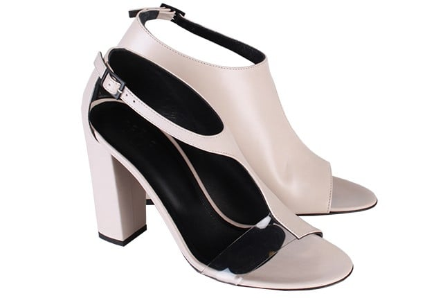 Pair Tibi's Elliot asymmetric sandals ($465) with a pencil skirt and structured top for a modern take on office dressing.