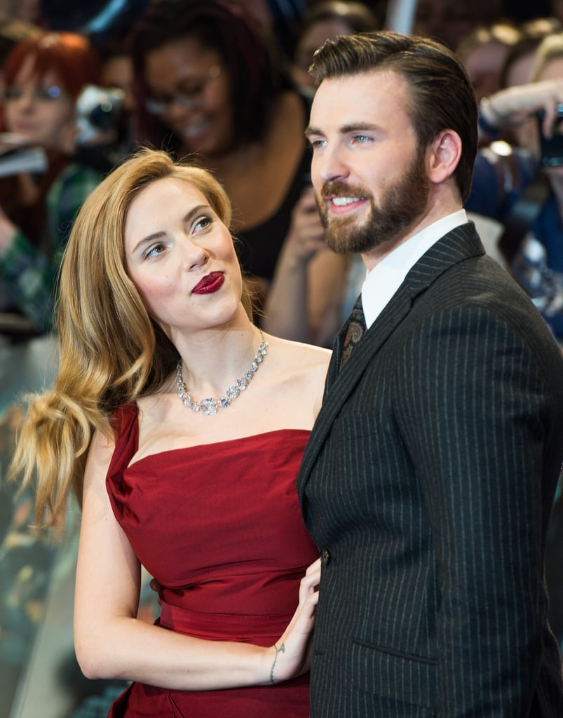 Scarlett Johansson walked the red carpet with Chris Evans at the UK premiere of Captain America: The Winter Soldier in London on Thursday.