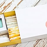 Le Parcel  For $15 (plus shipping) Le Parcel sends you a monthly box with period products plus chocolate and a gift. One past box had a nice ChapStick and a cake pop. How it works: You choose up to 30 of the period products you want — be they tampons, pads, or liners — in any combination you want and whichever brands you choose (they currently carry Tampax, Playtex, Kotex, and OB). You then put in the date of delivery, and they deliver the products along with a gift and a sweet treat to your door.