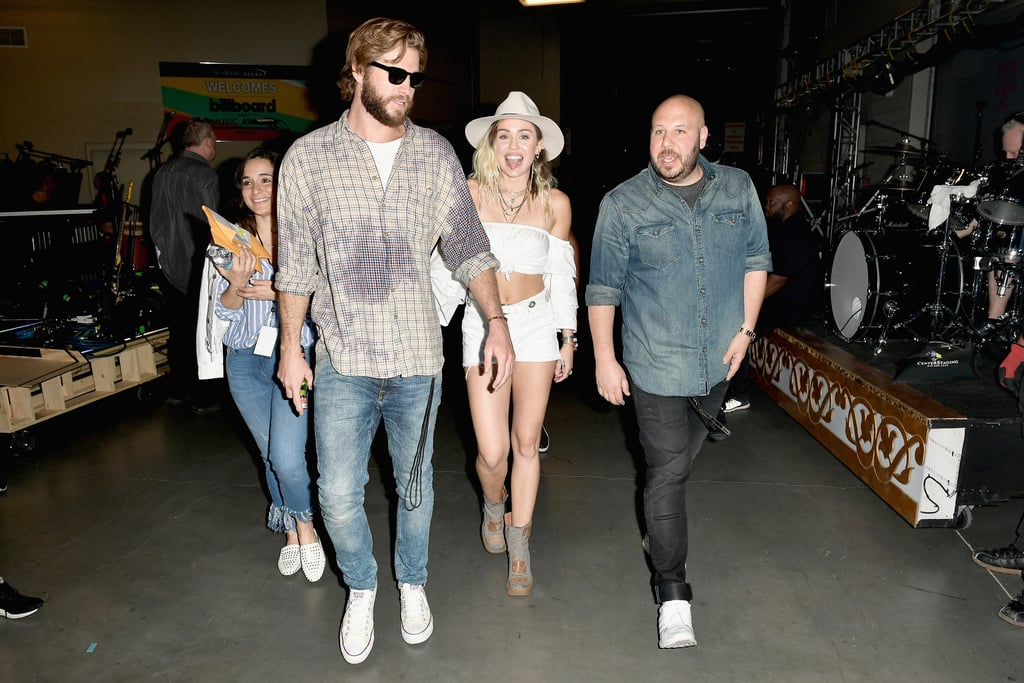 "Miley Cyrus had the support of her family and fiancé, Liam Hemsworth, at the Billboard Music Awards on Sunday. Aside from goofing off with her sister and mom in the audience, she also shared a sweet moment with Liam backstage. Seeing that she sang her hit ""Malibu"" — which is about their rekindled romance — during the show, it makes her emotional performance even more tear-inducing knowing that he was watching backstage."