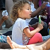 Nahla Aubry played at the park and cooled off with a snack.