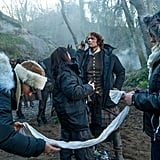 Heughan gets touched up between scenes.