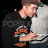 Robert Pattinson Greets With Fans With a Smile During Late Night on Cosmopolis Set