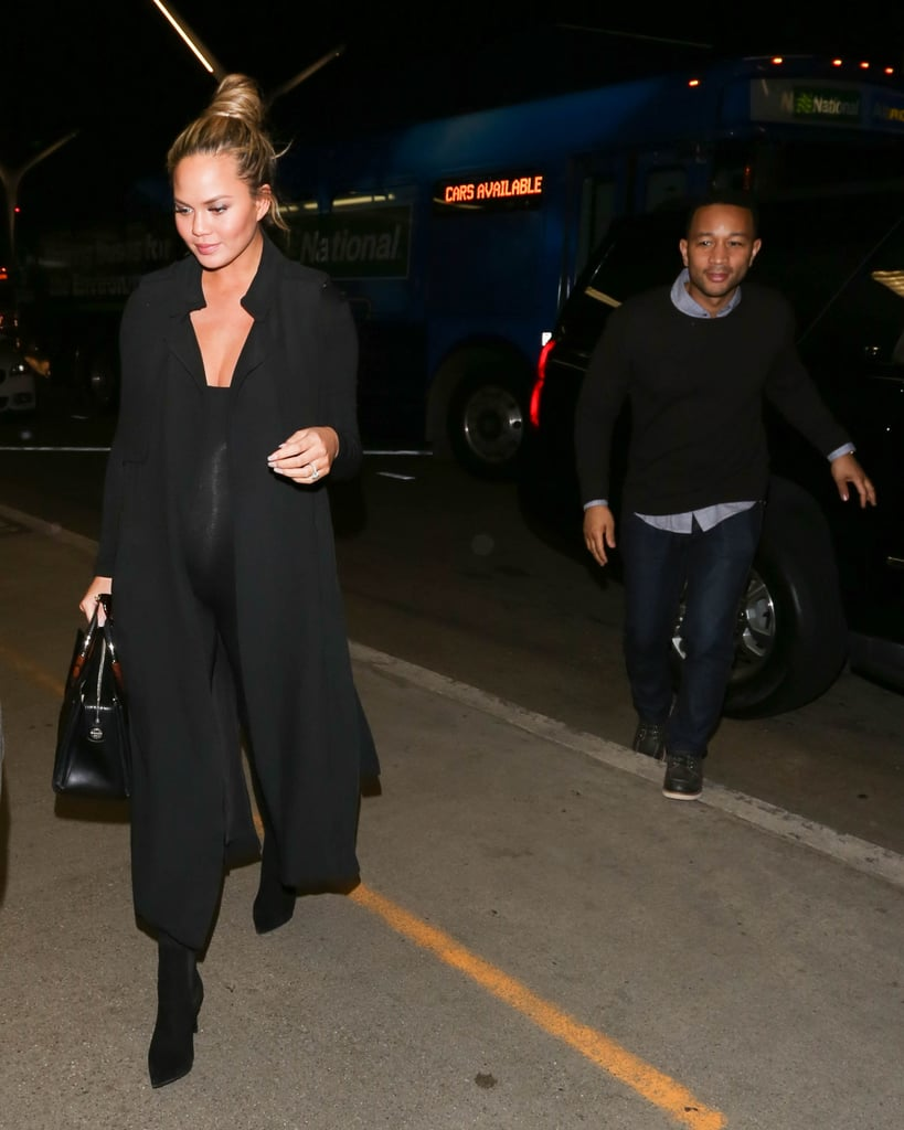 Chrissy impressed us with her night-out street style, which is anything but laid-back, throwing a long black trench over a tight-fitting jumpsuit and accessorizing with luxe accessories.