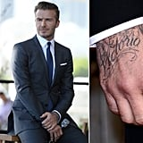 "You don't need to put your glasses on to spot the big ""Victoria"" tattoo on David Beckham's right hand."