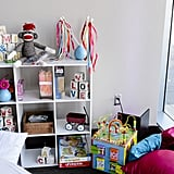 Since Mimi and Stuart knew there would be a lot of kids in attendence, it was important to the couple to embrace them and make them feel included while giving the parents a way to enjoy themselves. So Alicia's team created a very in-depth, detailed childrens' area. It had games, arts and crafts, toys, and even its own lounge furniture.  Photo by Chrisman Studios