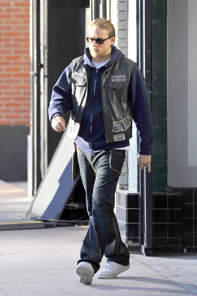 """He may not be in Fifty Shades of Grey anymore, but that doesn't mean that Charlie Hunnam is out of work. The actor returned to the set of his hit FX series, Sons of Anarchy, in LA on Monday, just a few days after it was announced that he was dropping out of the highly anticipated film based on the erotic novel by E L James. While the official word has been that Charlie dropped out of the film due to scheduling conflicts with Sons of Anarchy, many fans aren't buying that excuse, especially since scheduling was most likely worked out before Charlie signed on for the gig. Plenty of people have begun to speculate why Charlie dropped out of Fifty Shades of Grey, with many saying that the actor was turned off by the media attention and one source even saying that Charlie """"was never going to do"""" the film and had told his agents early on that he was planning to pull out. Another tipster claimed that Charlie didn't want to become Robert Pattinson, who shot to fame with the Twilight series. One thing that all the sources seem to agree on is that Charlie is dedicated to his work on Sons of Anarchy. Charlie has been going about his business ever since he announced his departure from the project. He spent the weekend serving as the best man at his pal's wedding in LA."""