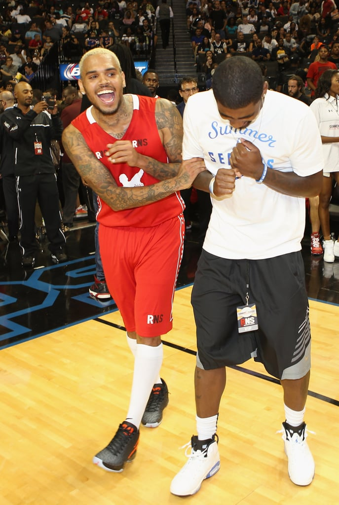 Chris Brown joked around with Kyrie Irving during the game.