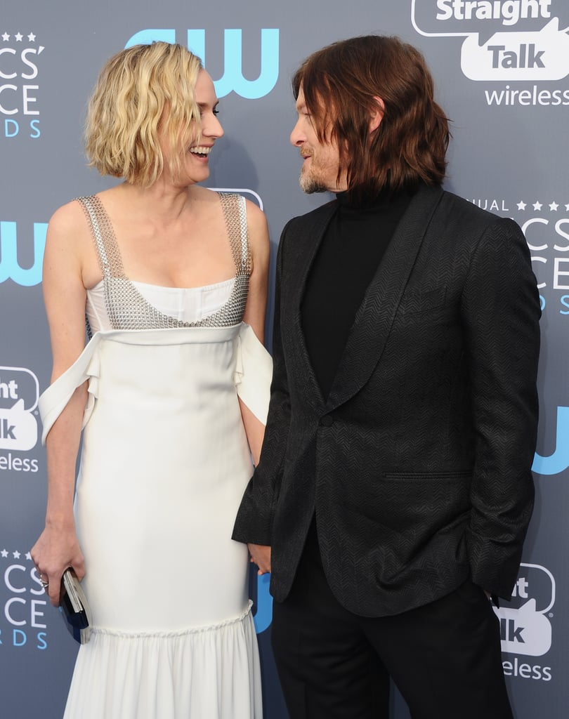 Diane Kruger and Norman Reedus have been quietly dating since 2016, but it seems the couple are becoming more and more comfortable with publicly displaying their relationship. After popping up at the Golden Globe Awards, the couple stepped out together again at the Critics' Choice Awards in Santa Monica, California, on Thursday. Diane was on hand to support Norman, who is nominated for best unstructured reality series for his show Ride With Norman Reedus, and their PDA on the red carpet almost gave us a toothache. Not only were they basically the heart-eyes emoji, but at one point, Norman even grabbed Diane's hand and kissed it. Aw!