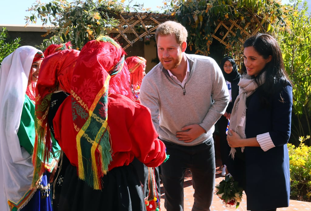 Prince Harry and Meghan Markle's Morocco tour kicked off on Saturday, and the cute couple is already making their rounds in the country. On Sunday, the royal duo visited Education For All's local accommodate and Lycée Qualifiant Grand Atlas secondary school in the town of Asni in the Atlas Mountains. There, they learned all about Morocco's efforts to promote education equality. During the trip, Meghan and Harry — who are expecting their first child in the Spring — learned about EFA's mission to help young students gain access to secondary education by building boarding houses. They stopped by classrooms, spoke with some of the girls EFA has helped, had a few sweet interactions with young fans, and attended a ceremony where Harry awarded EFA member Mike McHugo with an MBE (Member of the Most Excellent Order of the British Empire) award. Meghan — who has previously been an outspoken advocate for higher education — even impressed a few people with her French skills!  When the soon-to-be parents visited Lycée Qualifiant Grand Atlas secondary school, they chatted with teachers and got to see how some of the students are learning English. Meghan also took a moment to get a henna tattoo as a part of Morocco's tradition for pregnant women. Ahead, photos from Harry and Meghan's trip during day two of their tour!      Related:                                                                                                           Meghan Markle's Royal Tour Wardrobe Is a Lesson in How to Pack For Every Occasion