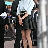 Diane Kruger offered up an edgier look in this cool-girl Balmain getup. She paired a denim top with military-style buttons with a leather miniskirt. Then she added cool-girl laser-cut peep-toed booties for the finishing touch.