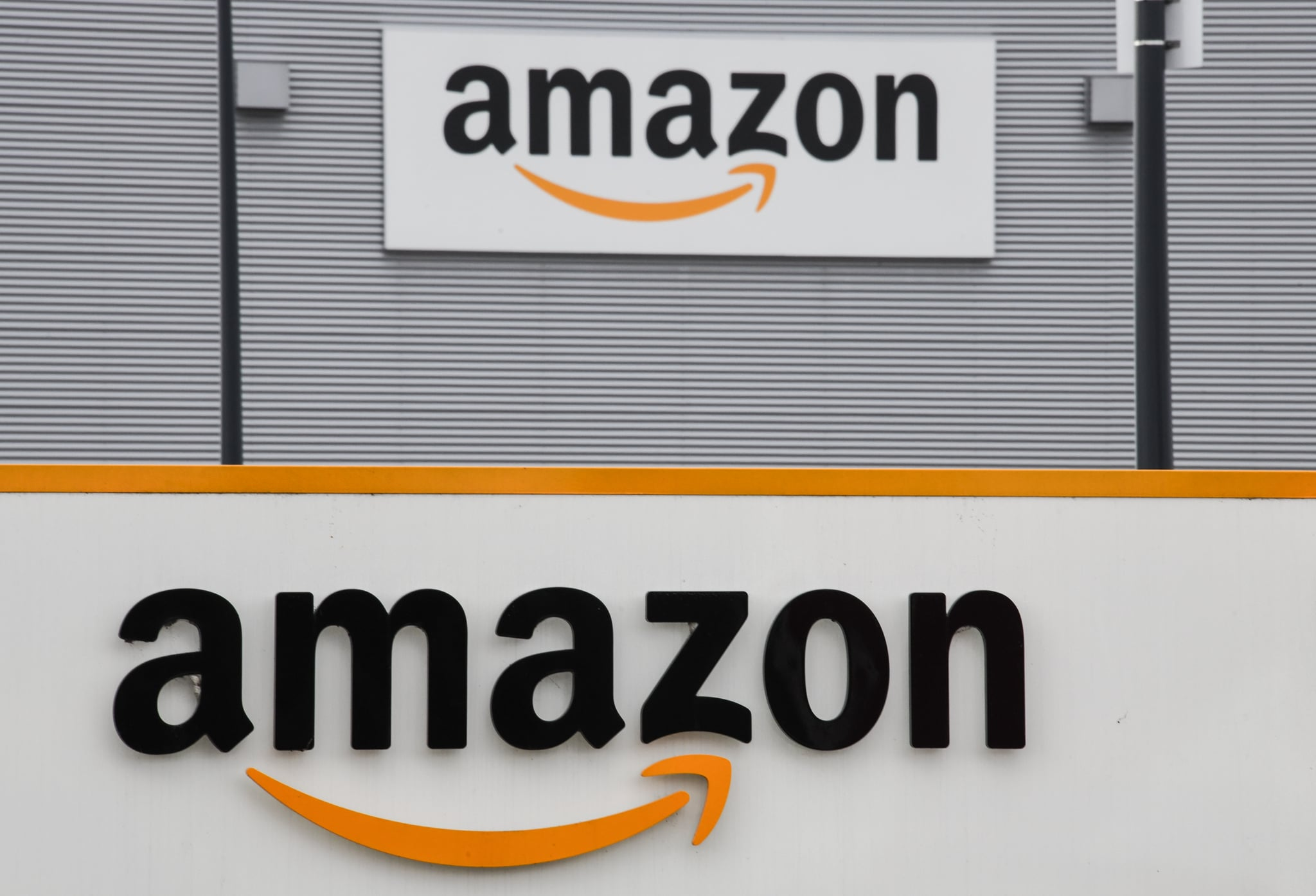 A picture shows the Amazon logo at the entrance area of the Amazon logistics centre in Lauwin-Planque, northern France, on March 4, 2019. (Photo by DENIS CHARLET / AFP)        (Photo credit should read DENIS CHARLET/AFP/Getty Images)