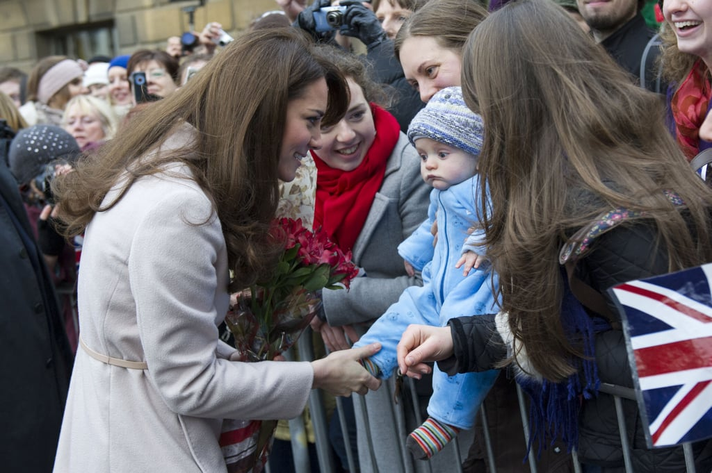 Kate was still keeping her first pregnancy a secret on Nov. 28, 2012, when she was joined by Prince William to visit their namesake town, Cambridge.