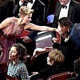Terrence Howard gave Scarlett Johansson a quick kiss.