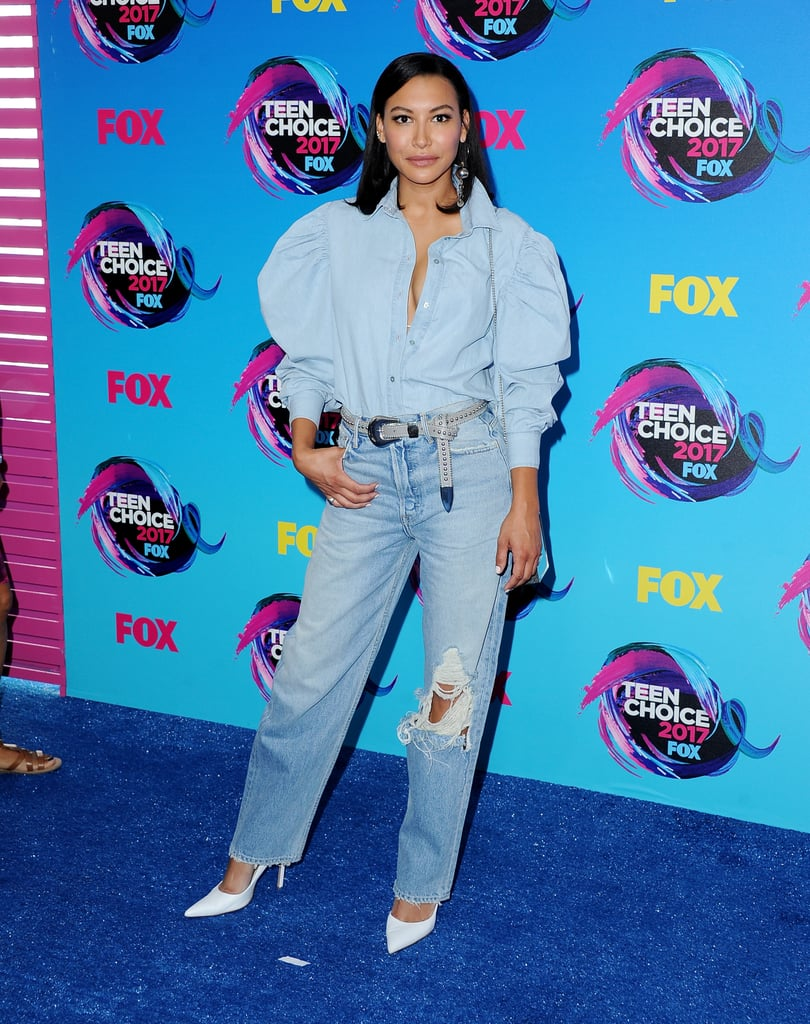 365fb542f3 Naya Rivera wore a blue button-down top that featured puffy sleeves. She  tucked the shirt into a pair of straight-leg jeans.