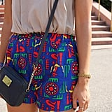This woman got her mini bag from Michael Kors, but those brightly colored shorts came straight from her mother's old wardrobe in Japan!