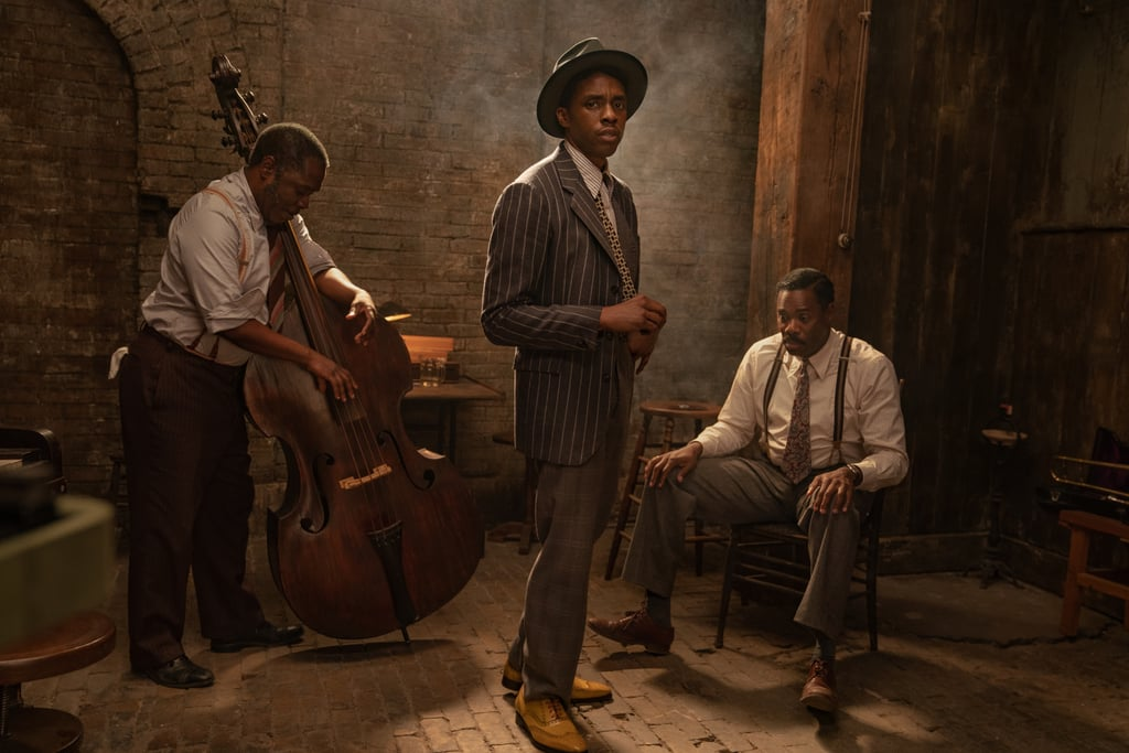 """The unexpected announcement of Chadwick Boseman's death on Aug. 28 has inspired many fans to look at the many roles he's played throughout his career and the impact of his performances, including those yet to be seen. Netflix's upcoming drama Ma Rainey's Black Bottom, an adaptation of the famed August Wilson play, will serve as Boseman's final film, the last of the several he took on during his four-year battle with colon cancer.  Directed by George C. Wolfe and produced by Denzel Washington – who had a special connection with the late actor after privately paying for Boseman and other Howard University students to attend an acting program at England's Oxford University years ago — the adaptation of the acclaimed 1982 film follows the pioneering """"queen of the blues"""" and her band members. Viola Davis stars as the aforementioned queen who fights with her white producers for control over her music alongside Glynn Turman, Colman Domingo, Taylour Paige, and Michael Potts. Boseman plays Levee, a talented but troubled trumpet player who is determined to stake his claim on the music industry. On Sept. 30, the streamer revealed that Ma Rainey's Black Bottom is slated to premiere on Dec. 18, dropping a first look at the film as well.  The streamer recently canceled a preview event for the film in the wake of the actor's death, releasing a statement with the news. """"We are heartbroken over today's news of the passing of Chadwick Boseman, a 'true fighter' as his family called him in their poignant tribute,"""" the statement reads. """"This is an incredible loss. Please join us in sending your thoughts to his family and loved ones."""""""