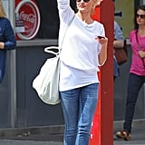 Cameron Diaz raised her arm to hail a taxi in NYC.