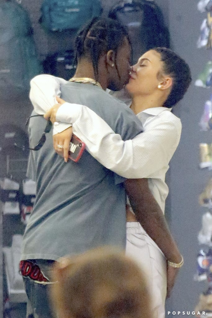 Kylie Jenner and Travis Scott can't get enough of each other! Just one day after making their red carpet debut as a couple at the Met Gala, the proud parents of baby Stormi were spotted packing on the PDA while shopping at Stadium Goods in NYC on Tuesday. Kylie and Travis, who were joined by Kylie's BFF Jordyn Woods, couldn't keep their hands off each other as they shared a sweet kiss and hug.  Later that night, Kylie reunited with her mom, Kris Jenner, and her sisters Kendall Jenner and Kim Kardashian at the Business of Fashion issue launch event. In true Kylie fashion, the 20-year-old showed off her famous curves in a figure-hugging Céline dress.       Related:                                                                                                           The Way They Were: 30 Times Kylie Jenner and Travis Scott Gave Us a Peek at Their Romance