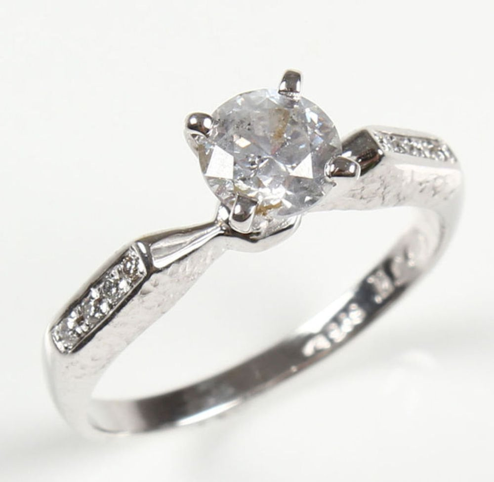 Sparkle in this elegant solitaire ring ($965) with accents.