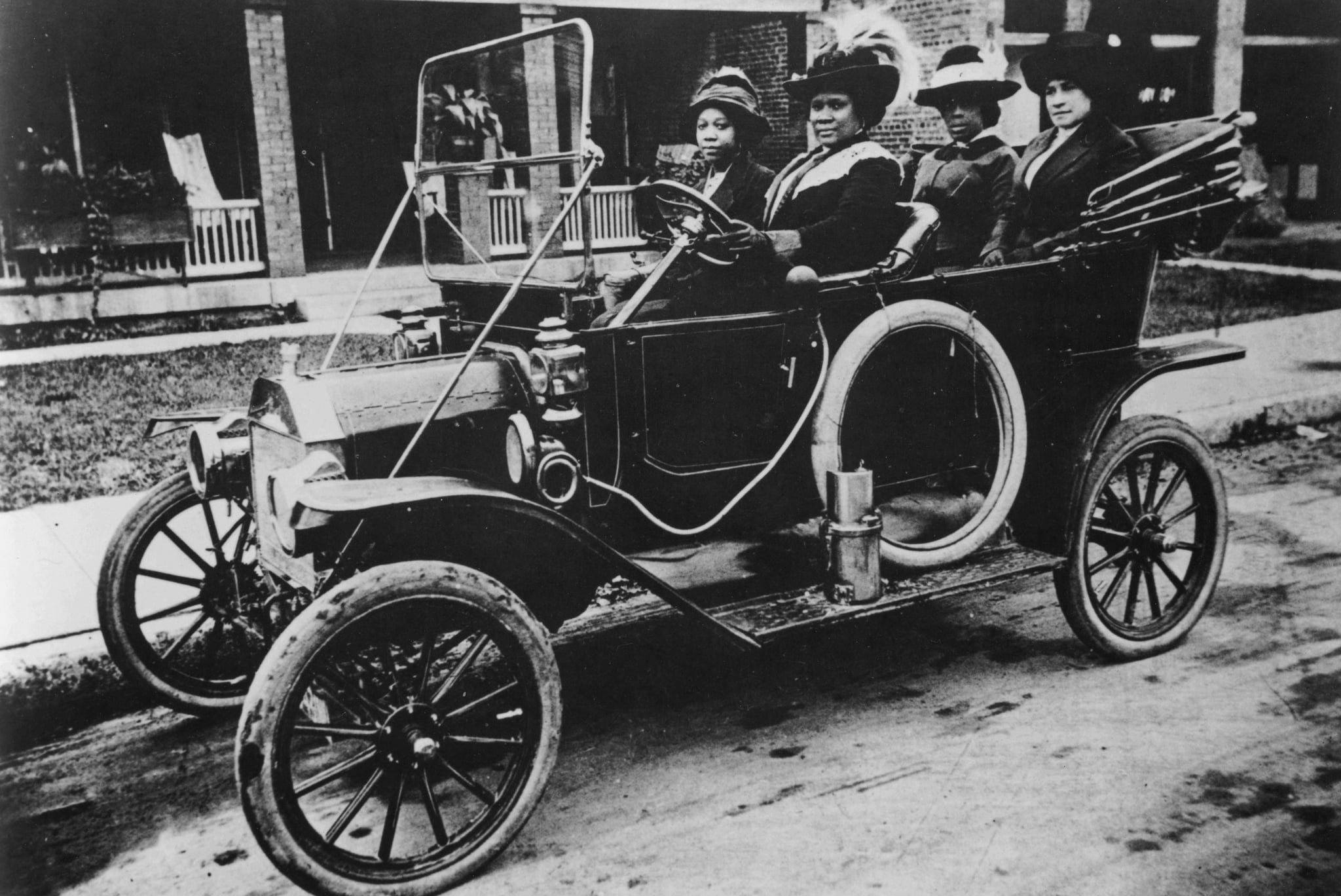 A photograph of Sarah Breedlove driving a car, she was better known as Madam C.J. Walker, the first woman to become a self-made millionaire in the United States, 1911. From the New York Public Library. (Photo by Smith Collection/Gado/Getty Images).