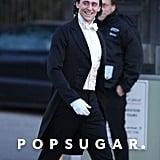 Tom got dressed up to film on April 23.