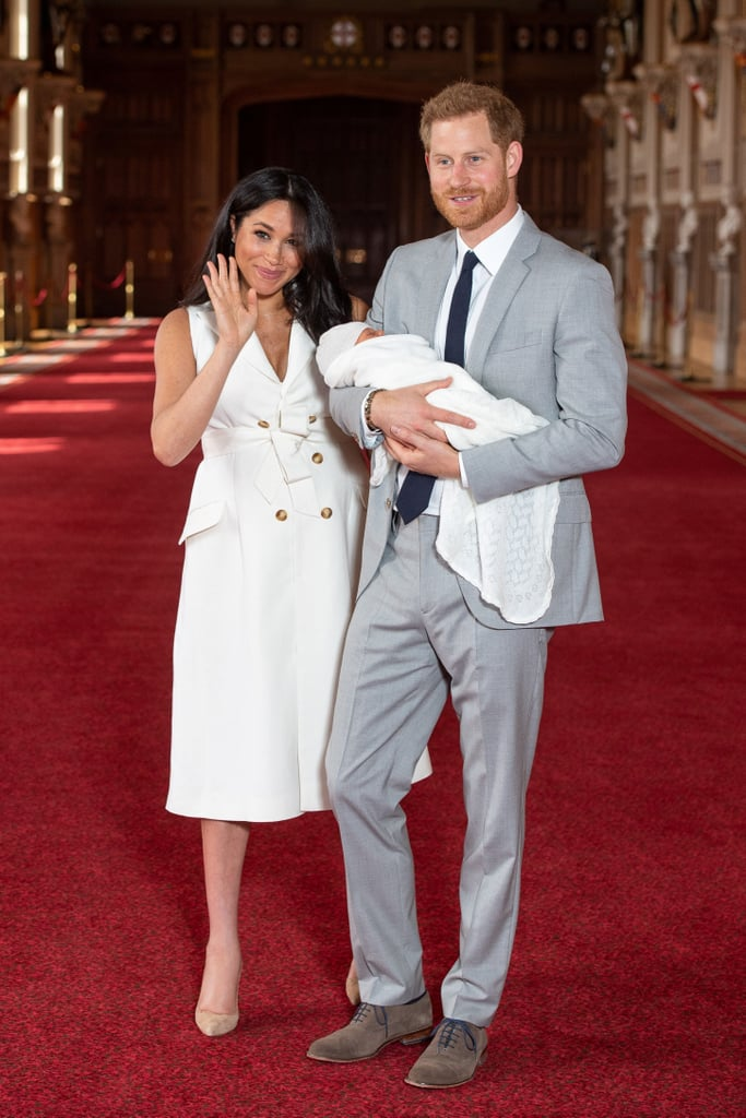 Meghan and Harry made sure to shake things up by having Harry hold his bundle of joy —feminism at its finest.