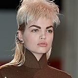 "Guido and his team cut 34 wigs individually for each model, working with each face shape on site at the show. He explained that he wanted to ""make them look as good as possible so it's like a haircut on each girl."" Unlike other shows he's worked on this season like Marc Jacobs, these were inexpensive hairpieces as opposed to lace-front wigs."