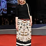 Lily Cole chose a less-formal approach to red-carpet dressing with her bird-printed maxi skirt, booties, and black sweater.