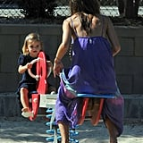 Alessandra Ambrosio and Anja play on a seesaw.