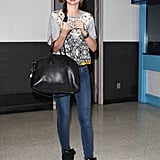 Fresh off the plane at LAX, Miranda was the picture of laid-back, cool travel style in a statement-print tee, skinny denim, and Isabel Marant high-tops with a Givenchy bag in tow.