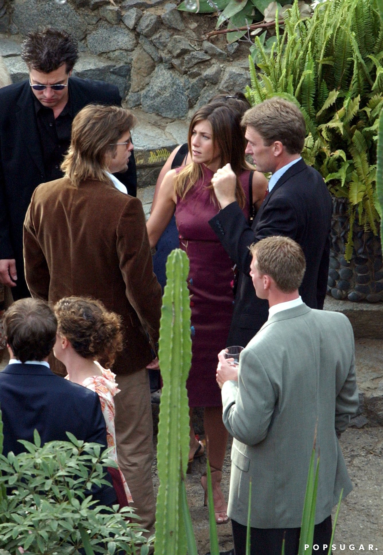Brad Pitt showed support for Jennifer Aniston as a bridesmaid in a friend's LA wedding in November 2002.