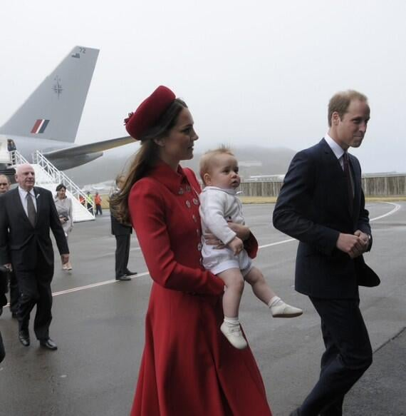 Prince George wiggled in his mother's arms as they arrived in New Zealand. Source: Twitter user GovGeneralNZ