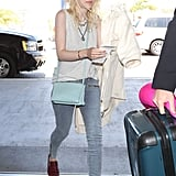 Wear a Comfortable Pair to the Airport Like Dakota Fanning