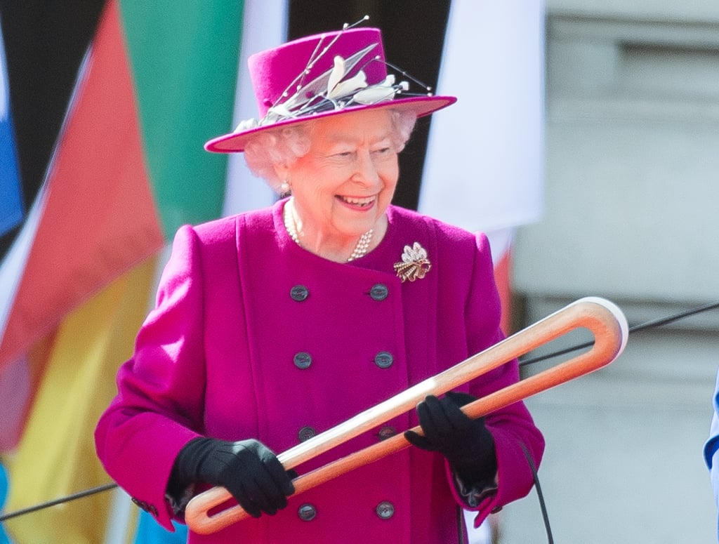 """While you were struggling to get out of bed and make coffee on Monday morning, Britain's Queen Elizabeth II spent a few hours celebrating the unity of the 52 countries that make up the Commonwealth of Nations (all in a day's work, right?). The 90-year-old monarch arrived outside Buckingham Palace with husband Prince Philip, Prince Edward, and Commonwealth Games Federation President Louise Martin to launch the queen's baton relay for the XXI Commonwealth Games. Although she usually keeps a pretty straight face, the queen flashed a big smile while handing off the baton to retired Australian cyclist Anna Meares. The event follows the queen's message about building """"peace by defending the dignity of every individual and community."""" Her hand-off of the baton signals the start of the relay's 388-day journey around the Commonwealth. Eventually the relay will end when the baton arrives at the opening ceremony of the Gold Coast Games (which aren't set to start until April 4, 2018), much to the delight of the 2.5 billion citizens who make up the Commonwealth. Before it does, however, the baton will make another appearance in London during a service at Westminster Abbey, which is expected to see not only the queen and Prince Philip but also Prince Charles and wife Camilla, Prince Harry, Prince Andrew, and Prince Edward.  """"Over the next 12 months, the baton will visit people living in the nations and territories of our Commonwealth family in every continent and ocean,"""" the queen said. """"Carried on its way by thousands of people of all ages and backgrounds, by the time it reaches its final destination, the Queen's Baton will have brought together, through its route and symbolism, almost 2.5 billion people who share the special connection of being Commonwealth citizens. Contained within the Baton will be a written message that will be opened and read at the Commonwealth Games in Australia next year. However, there is an even more powerful message to be seen and experienced as the """