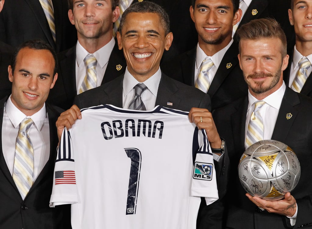 "The White House welcomed the LA Galaxy soccer club for a special event in Washington DC this afternoon. David Beckham was among his teammates as they were honored by President Obama and First Lady Michelle for their successful 2011 season and MLS Cup win. Landon Donovan presented the president with a custom jersey after Obama spoke a few words. Obama joked of David, ""It is a rare man who can be that tough on the field and also have his own line of underwear."" Later, the players participated in a question and answer section for Michelle's ""Let's Move"" campaign. David is in the nation's capital with the rest of the team after they traveled to Canada last week for a Saturday match against the Montreal Impact that resulted in a tie."